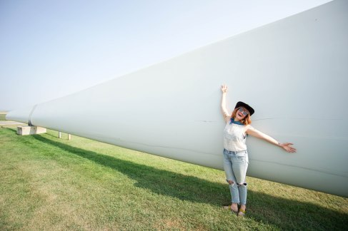 A wind turbine propeller outside Judith Gap, MT - Olivia for scale.