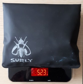 Surly pouch with brake pads, spare bolts and repair kits.